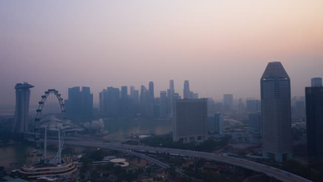 dolly forward hyper lapse aerial view smog pm2.5 from forest fire in singapore - fade out video transition stock videos & royalty-free footage