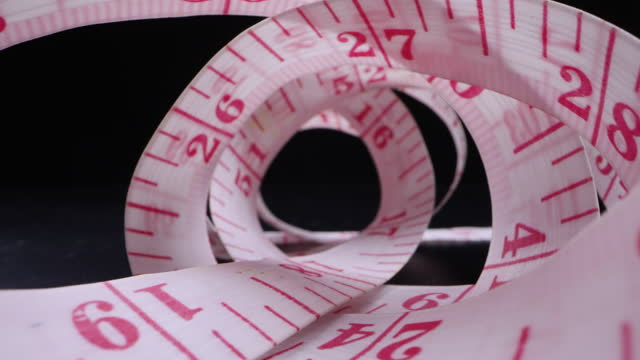 dolly in of tape measure - meter instrument of measurement stock videos & royalty-free footage