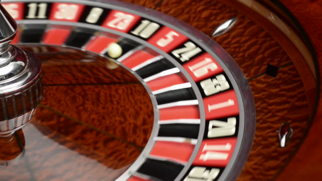dolly in to spinning roulette wheel - roulette stock videos and b-roll footage