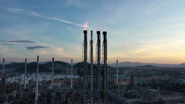 dolly left of flare stack in sunset time - oil industry stock videos & royalty-free footage