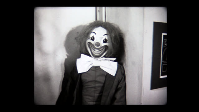1971 dolly move into costumed clown doll - black and white stock videos & royalty-free footage