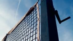 Dolly of tennis net in sunset, 4k, slow motion 75fps