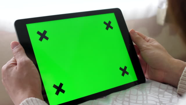 dolly out:digital tablet chromakey at bed - casual clothing stock videos & royalty-free footage