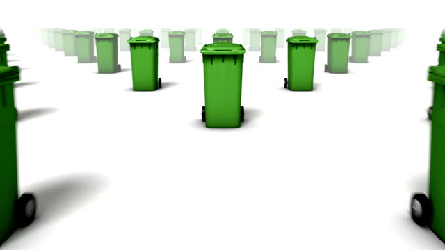 dolly over many trash cans to single can (green) - wastepaper bin stock videos & royalty-free footage