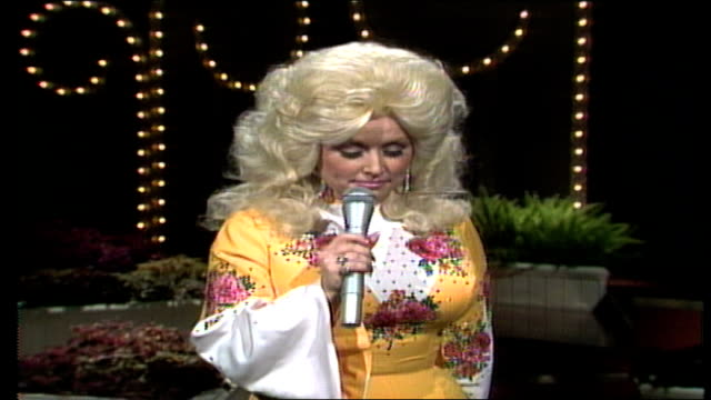 dolly parton wearing bright yellow jumpsuit decorated with rhinestone flowers and butterflies says ever since she was a little girl she's wanted to... - jumpsuit stock videos and b-roll footage