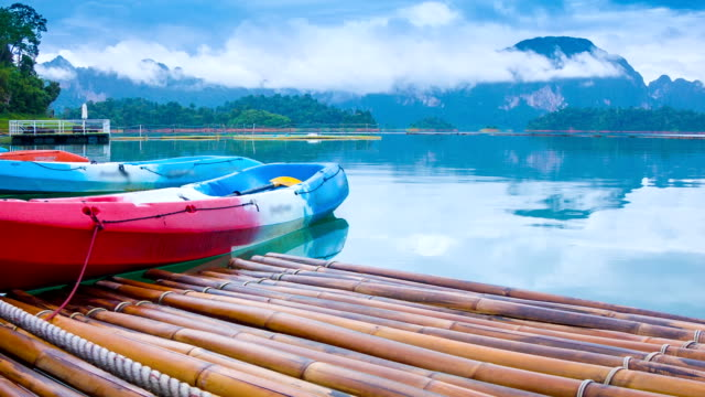 HD Dolly : reflection of mountain and kayak in lake