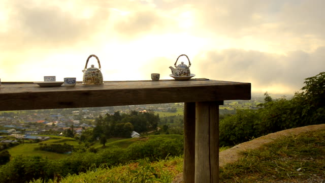 dolly: resting with chinese tea under sunrise - mae hong son province stock videos and b-roll footage