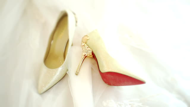 cu dolly right camera : white wedding shoes on wedding dress background. - dress shoe stock videos and b-roll footage
