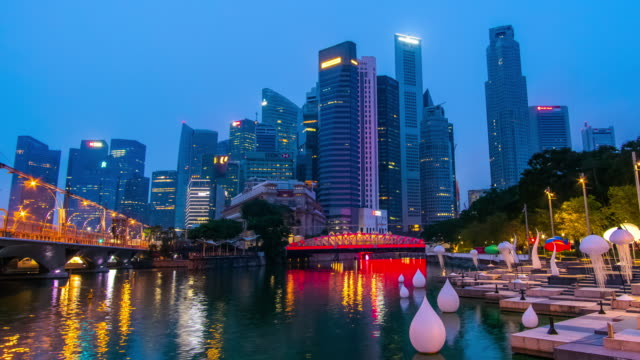 dolly right day to night timelapse of singapore cityscape - river singapore stock videos & royalty-free footage