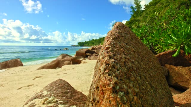 Dolly: Rocks at beautiful beach of Anse Fourmis