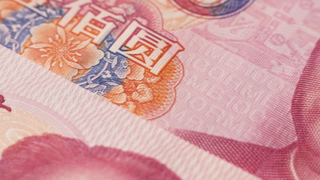 dolly shot across chinese currency - chinese currency stock videos & royalty-free footage