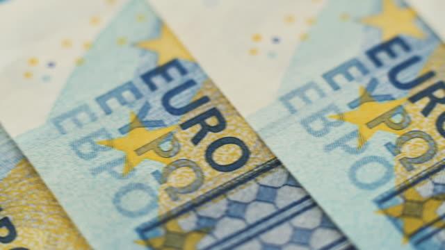 stockvideo's en b-roll-footage met dolly schot over eurobiljetten - lening