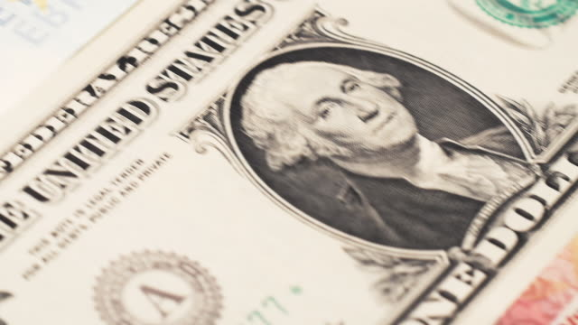 Dolly shot across international currency