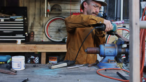 dolly shot across metalworker at work - dolly shot stock videos & royalty-free footage
