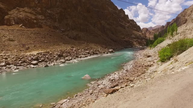 dolly shot along the ravi  river in a canyon - wide stock videos & royalty-free footage