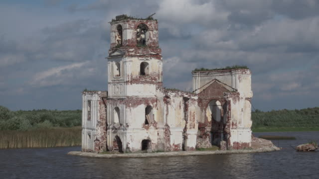 dolly shot ancien destroyed church sunken in river - extreme weather stock videos & royalty-free footage