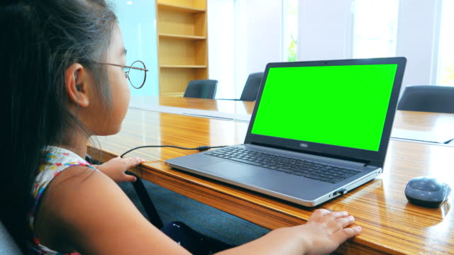 4k dolly shot: asian girl using desktop computer. - schoolgirl stock videos & royalty-free footage