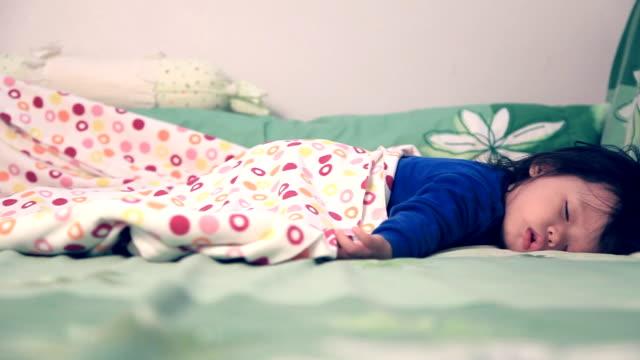 Dolly shot baby is sleeping in bedroom