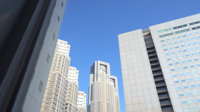 dolly shot: building tokyo cityscape - office building exterior stock videos & royalty-free footage