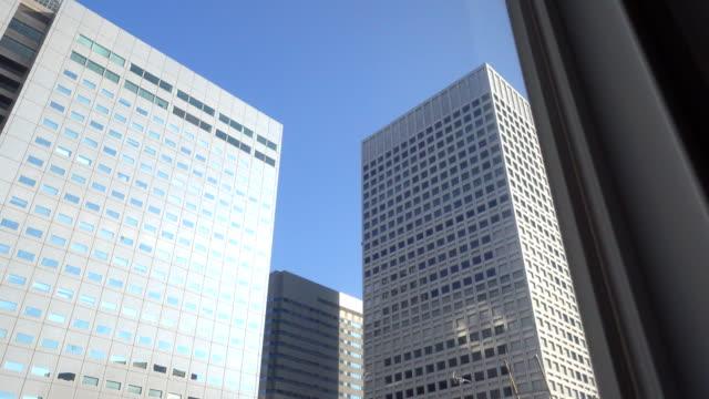 ドリー ショット: 建物東京の街並 - office block exterior点の映像素材/bロール