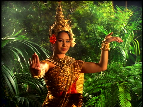 "dolly shot cambodian woman in native dress doing native dance in ""jungle"" - cambodian culture stock videos and b-roll footage"