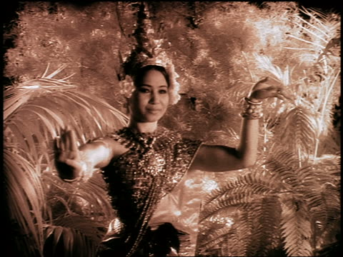"b/w infrared dolly shot cambodian woman in native dress doing native dance in ""jungle"" - cambodian culture stock videos and b-roll footage"