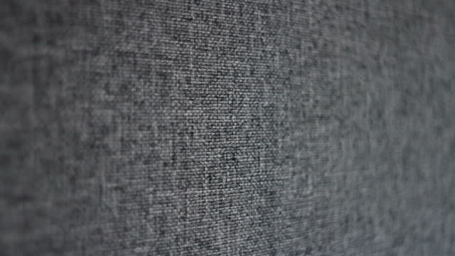 dolly shot. camera sliding over textured gray linen canvas fabric - textile industry stock videos & royalty-free footage