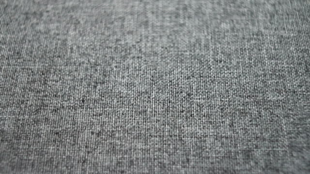 dolly shot. camera sliding over textured gray linen canvas fabric - full frame stock videos & royalty-free footage