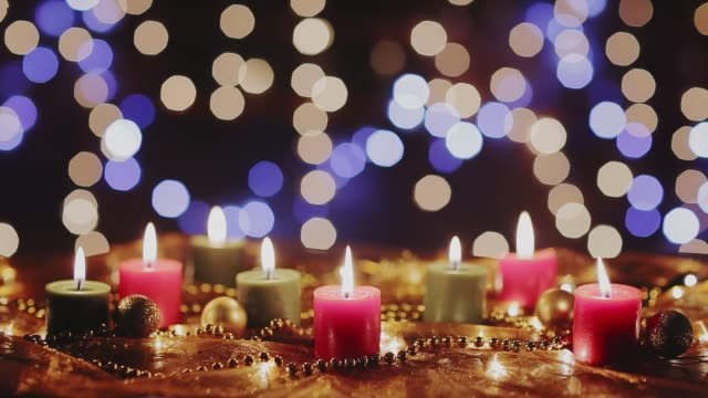 dolly shot christmas decoration on table with lights and candles. holiday backgrounds - christmas decore candle stock videos & royalty-free footage