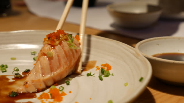 dolly shot close up:eat japanese food - toro fish stock videos and b-roll footage