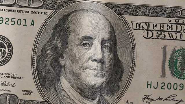 dolly shot:  close-up details of an american one hundred dollar banknote - american one hundred dollar bill stock videos & royalty-free footage