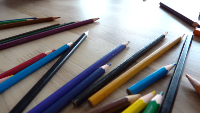 dolly shot: colored pencils on the desk - pencil isolated stock videos & royalty-free footage