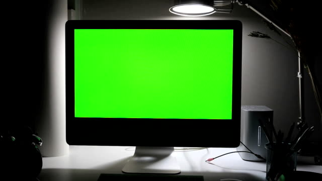 Dolly shot Computer screen green on the table