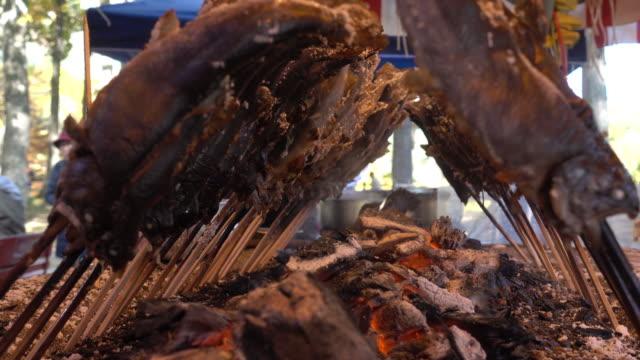 dolly shot: cooking of japanese river ayu fish BBQ