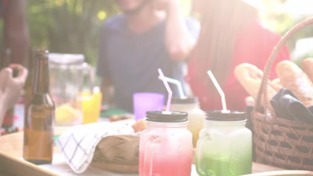 dolly shot defocus picnic in the garden - garden party stock videos & royalty-free footage