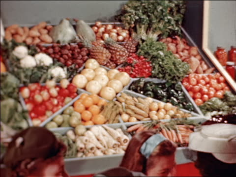 1946 dolly shot display of vegetables at state fair / industrial /audio - agricultural fair stock videos & royalty-free footage