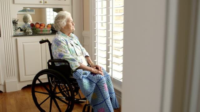 Dolly shot Elderly Person in a wheelchair