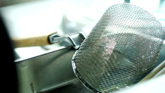 Dolly shot : Equipment noodle strainer ladle for soaking and prepare noodle in the kitchen.