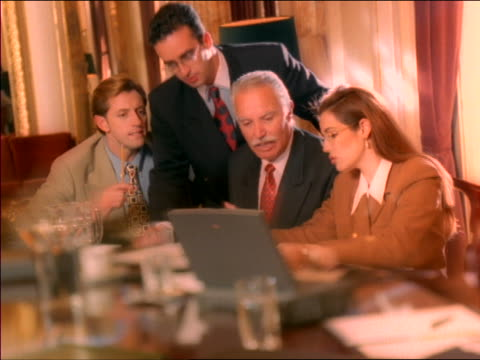 dolly shot group of businesspeople having meeting at table with laptop computer - board room stock videos & royalty-free footage