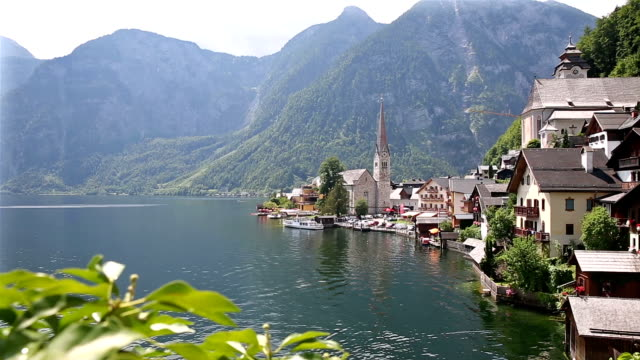 dolly shot: Hallstatt Village Cityscape lake Austria