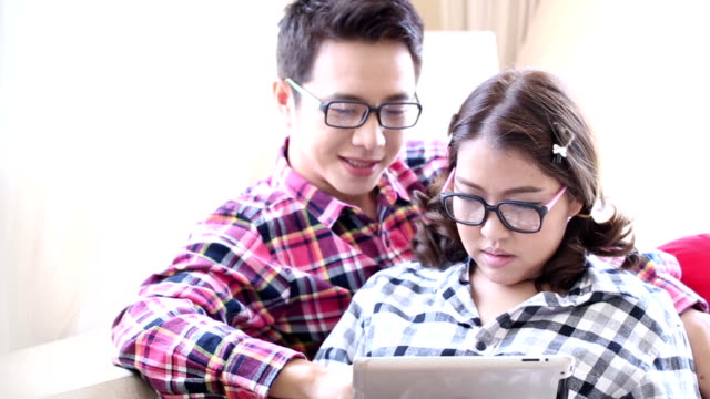 Dolly shot: Happy Couples using tablet together
