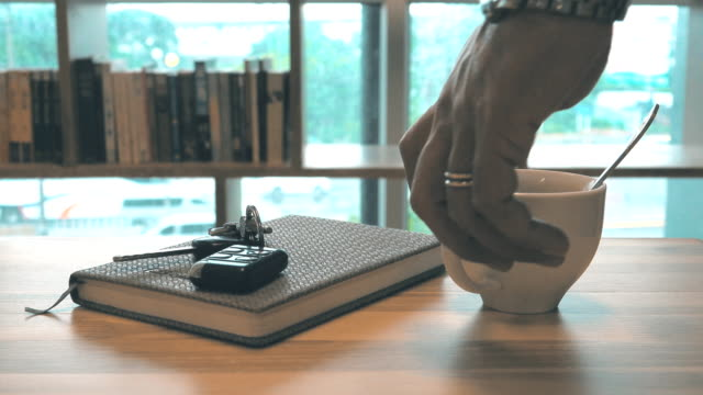 4k dolly shot: hot coffee art relax time in office - coffee table stock videos & royalty-free footage