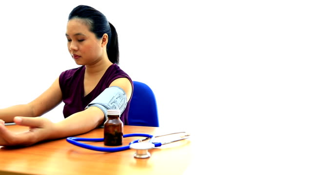 hd dolly shot: lady happy with her blood pressure test - hypertension stock videos and b-roll footage