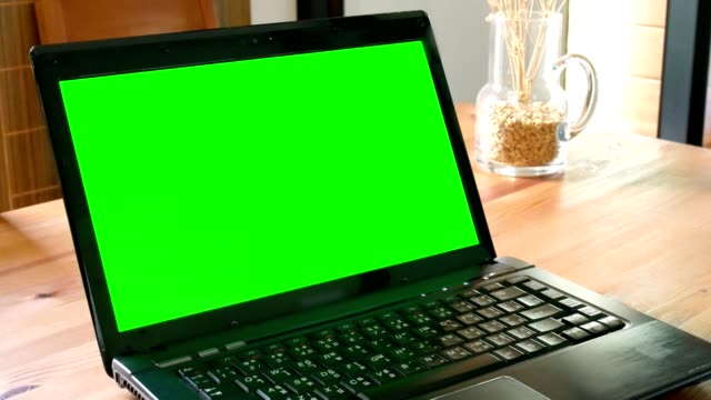 dolly shot: laptop computer with green screen chroma key on wooden table in living room - microsoft stock videos and b-roll footage