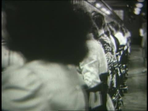 b/w 1946 dolly shot line of female telephone operators working at switchboard - 電話交換機点の映像素材/bロール