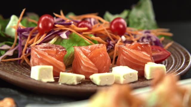 dolly shot : luxury salmon sashimi - salmon salad stock videos & royalty-free footage