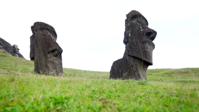dolly shot: moais on rano raraku - polynesian culture stock videos and b-roll footage