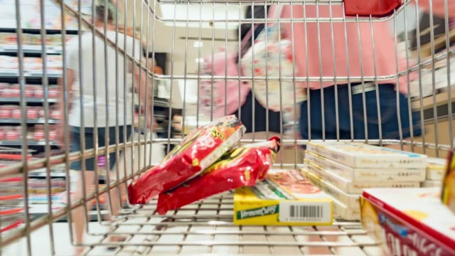 dolly shot; motion shopping in a supermarket. - trolley stock videos and b-roll footage