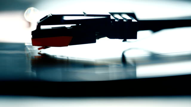 dolly shot of a record player playing a spinning vinyl lp - scratched stock videos & royalty-free footage