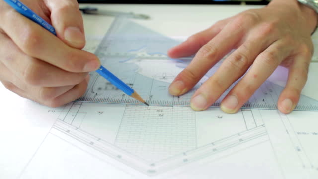 dolly shot of architect working on blueprint - ruler stock videos & royalty-free footage